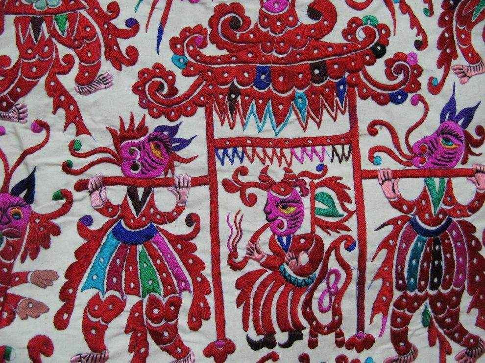 苗族刺绣对称剪纸图片